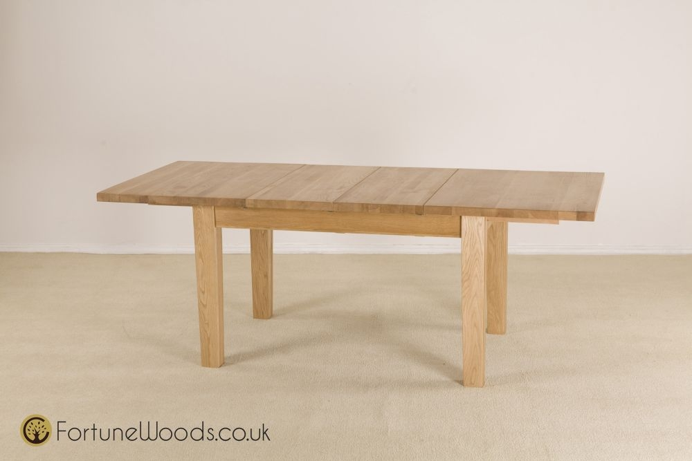 Buy tavistock oak dining table small extending with 2 for Small dining table with leaf