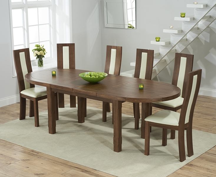 solid dark oak oval extending dining table with 6 havana cream chairs