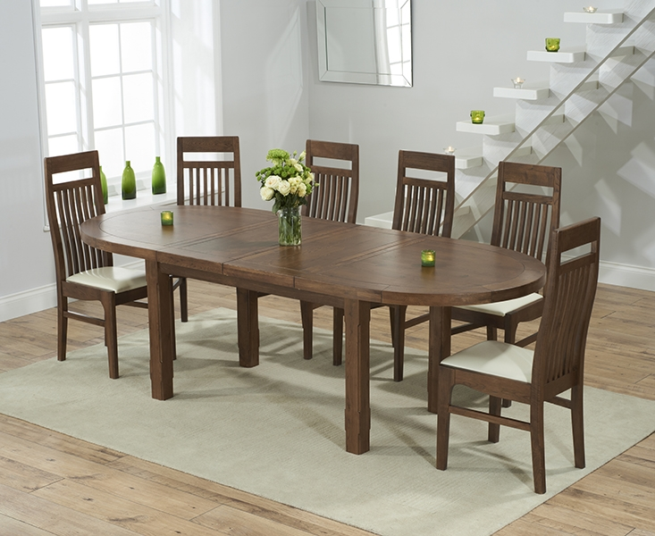 Mark Harris Cheyenne Solid Dark Oak Oval Extending Dining Table with 6 Monte Carlo Cream Chairs