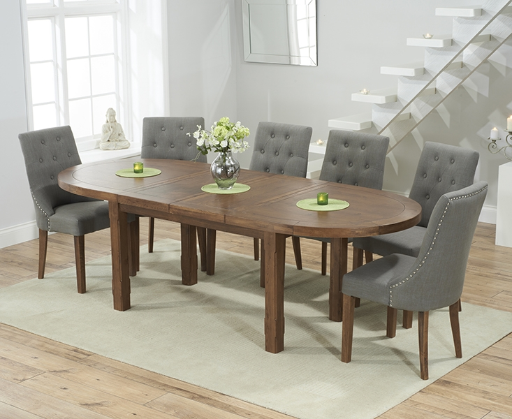 Mark Harris Cheyenne Solid Dark Oak Oval Extending Dining Table with 6 Pailin Grey Chairs