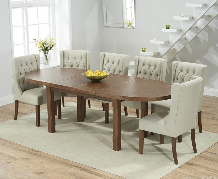 Mark Harris Cheyenne Solid Dark Oak Oval Extending Dining Table with 6 Stefini Beige Chairs