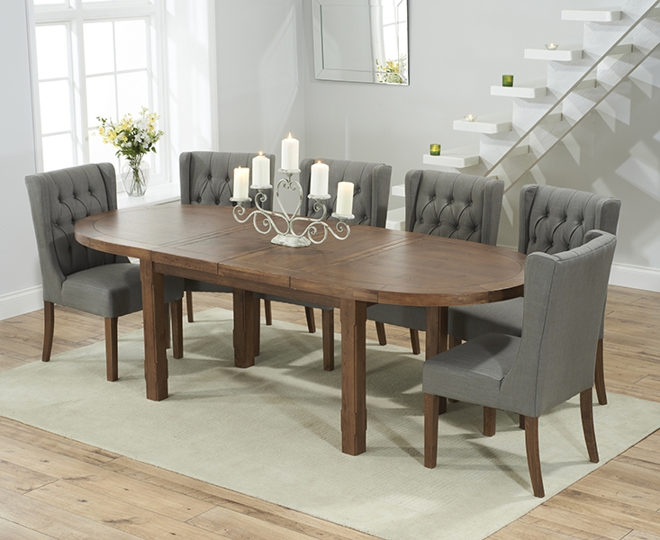 Mark Harris Cheyenne Solid Dark Oak Oval Extending Dining Table with 6 Stefini Grey Chairs