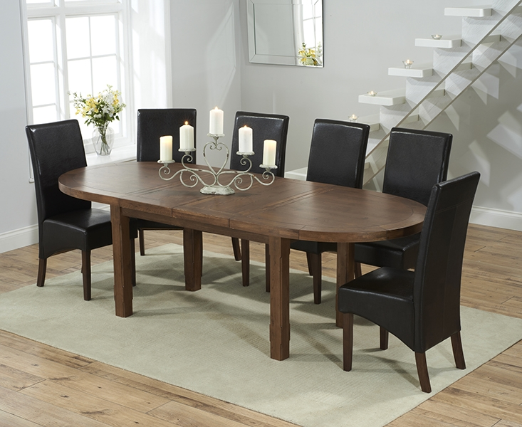 Mark Harris Cheyenne Solid Dark Oak Oval Extending Dining Table with 6 WNG Brown Chairs