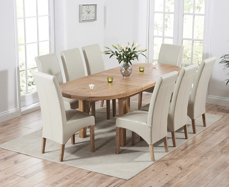 Mark Harris Cheyenne Solid Oak Oval Extending Dining Table with 8 Roma Cream Bycast Leather Chairs