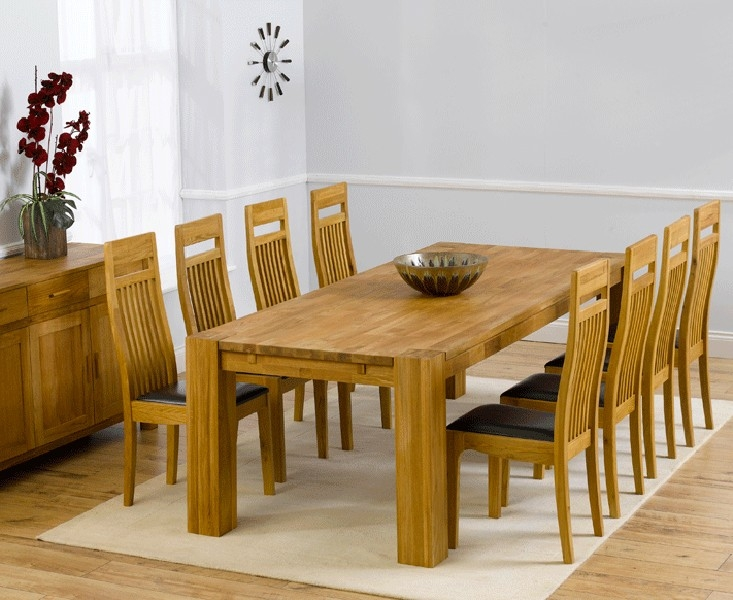 Mark Harris Madrid Solid Oak 240cm Extending Dining Table with 8 Monte Carlo Black Chairs