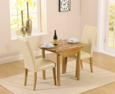 Mark Harris Promo Oak Round Drop Leaf Extending Dining Table and 2 Atlanta Cream Faux Leather Chairs