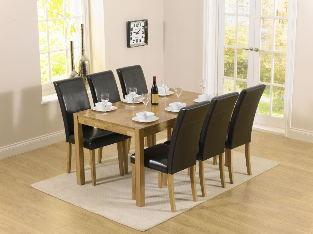 Mark Harris Promo Oak Dining Table and 6 Atlanta Black Faux Leather Chairs