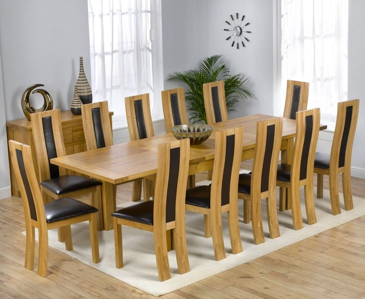 Mark Harris Rustique Solid Oak 180cm Extending Dining Set with 12 Havana Black Dining Chairs