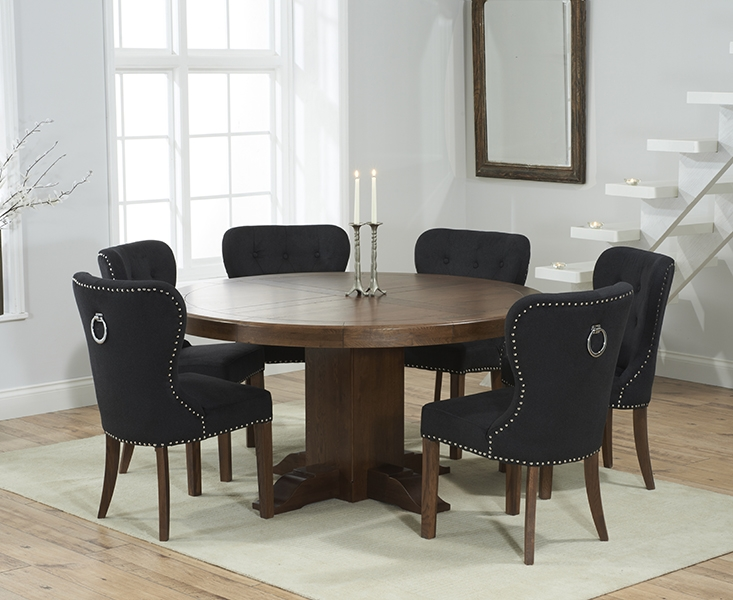 Mark Harris Turin Solid Dark Oak 150cm Round Pedestal Dining Table with 6 Kalim Black Chairs