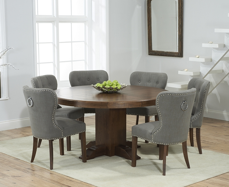 Mark Harris Turin Solid Dark Oak 150cm Round Pedestal Dining Set with 6 Kalim Grey Dining Chairs