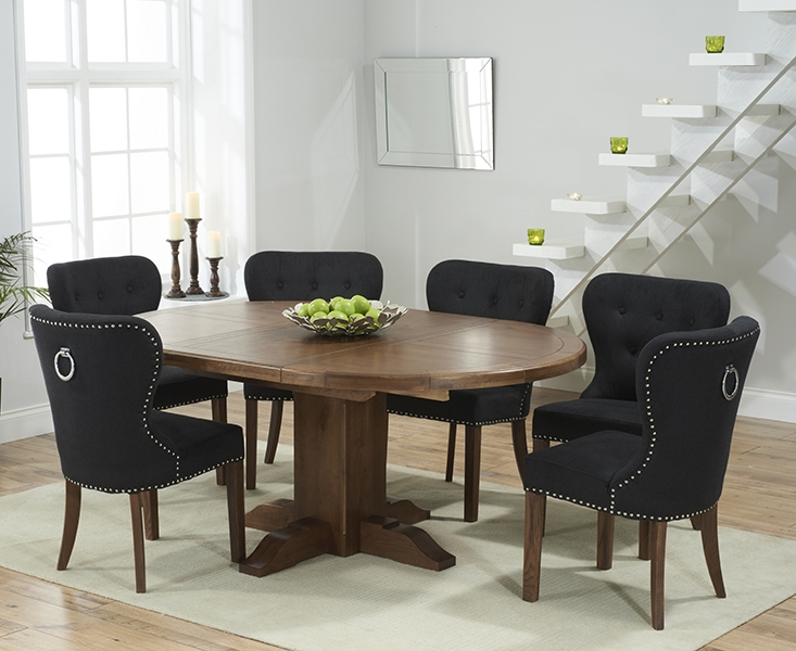 Mark Harris Turin Solid Dark Oak Round Extending Dining Table with 6 Kalim Black Chairs