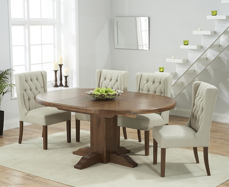 Mark Harris Turin Solid Dark Oak Round Extending Dining Table with 6 Stefini Beige Chairs