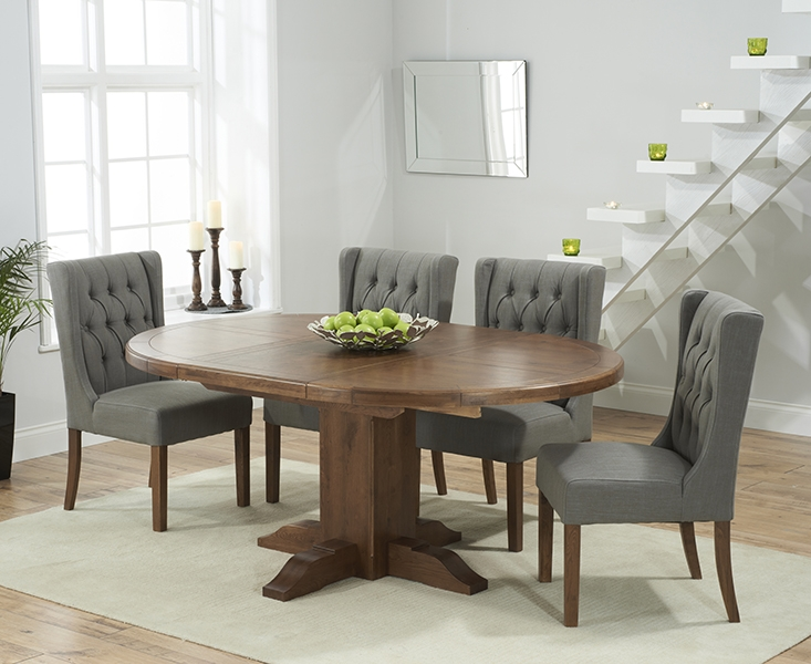 Mark Harris Turin Solid Dark Oak Round Extending Dining Table with 6 Stefini Grey Chairs
