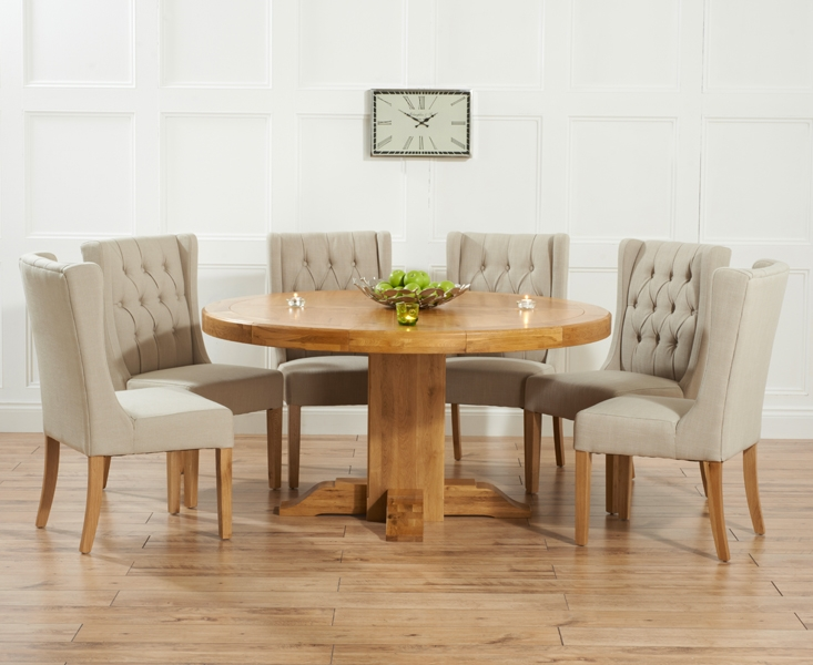 turin solid oak 150cm round dining table with 6 stefini beige chairs