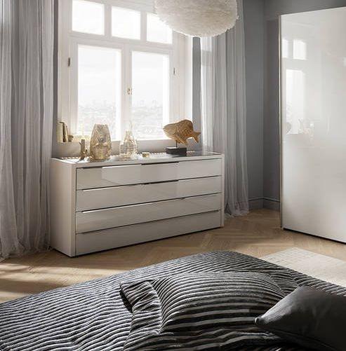 Nolte Attraction Lumina Polar White with White Glass 4 Drawer Chest with Lighting Top Board - W 127cm