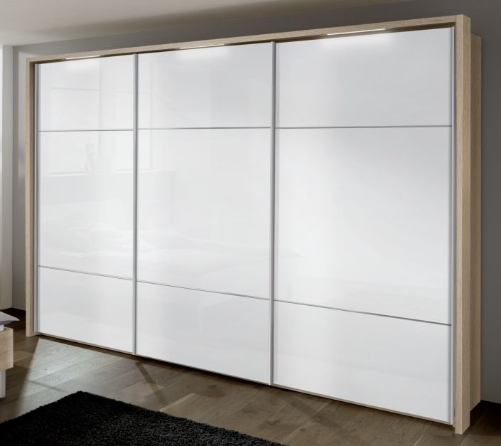 Nolte Velia 1 Version 3B Imitation Icona Beech with White Glass 3 Door Sliding Wardrobe with Pelmets and Passe Partout - W 300cm