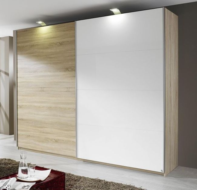 Product photograph showing Rauch Beluga Extra 3 Door Sliding Wardrobe In Jackson Hickory And Alpine White With Carcase Handle Strips - W 405cm