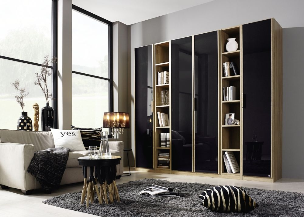 Rauch Essensa Sonoma Oak with Basalt Glass L Shaped Folding Wardrobe with Vertical Trims and Chrome Coloured Handle - W 251cm