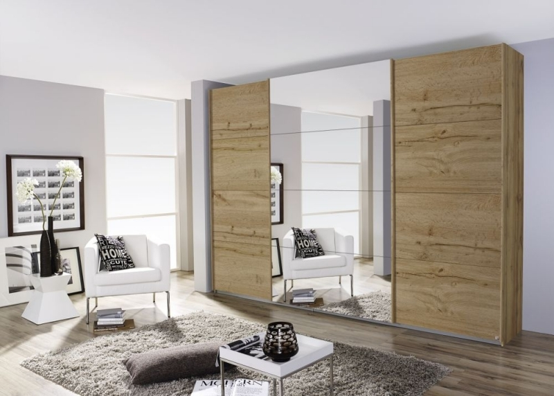 Rauch Quadra 3 Door Mirror Sliding Wardrobe in Wotan Oak - W 315cm