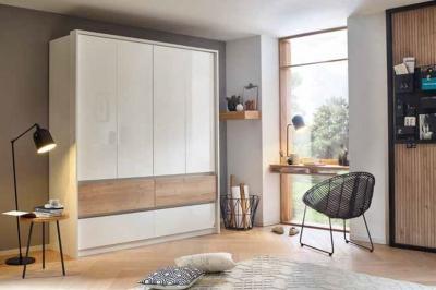 Rauch Winnipeg 4 Door 4 Drawer Combi Wardrobe in Alpine White and High Polish White with Halifax Oak - W 181cm