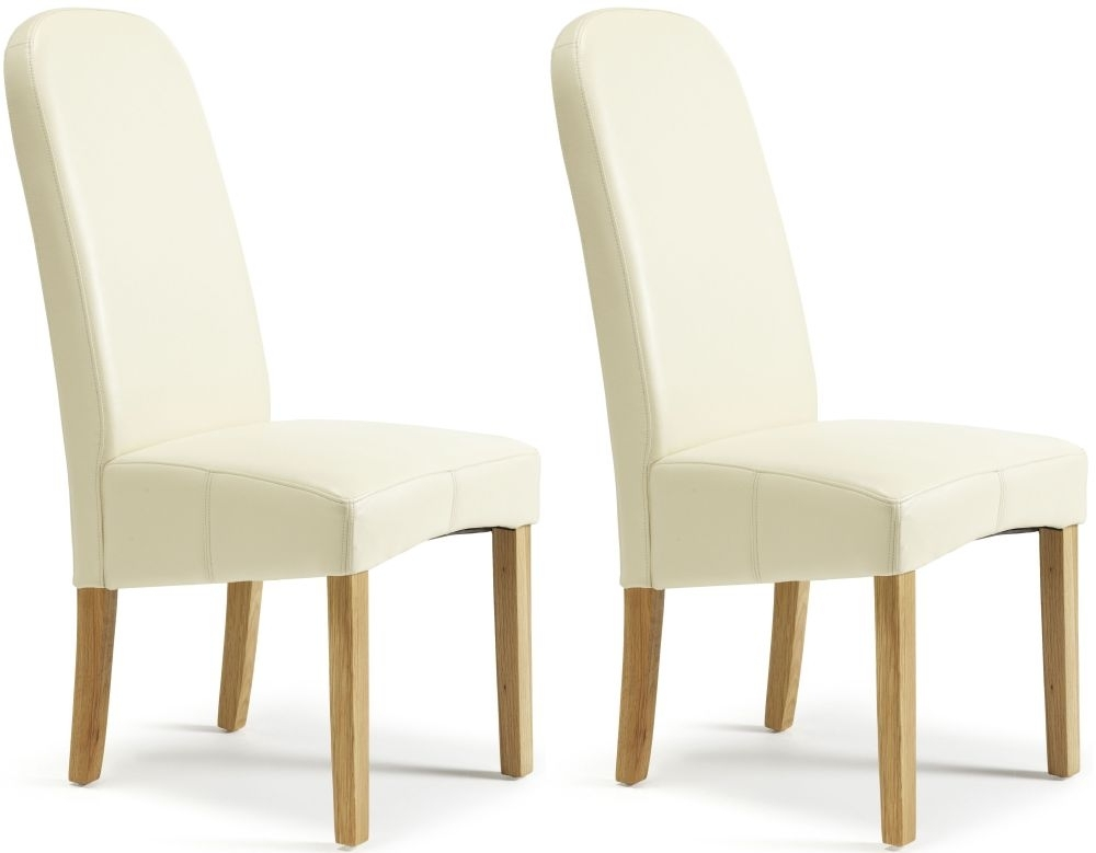 Buy serene marlow cream faux leather dining chair pair for Faux leather dining chairs