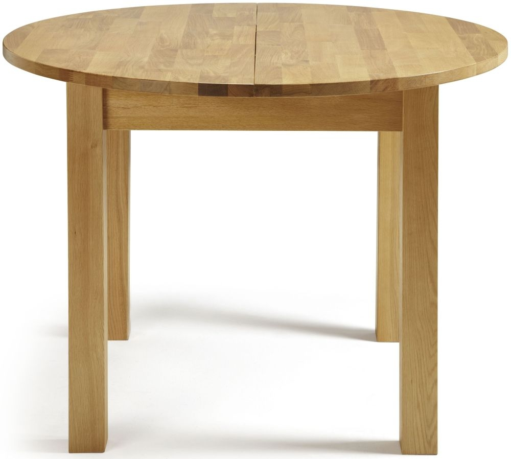 Buy serene sutton oak dining table round extending for Round extendable dining table