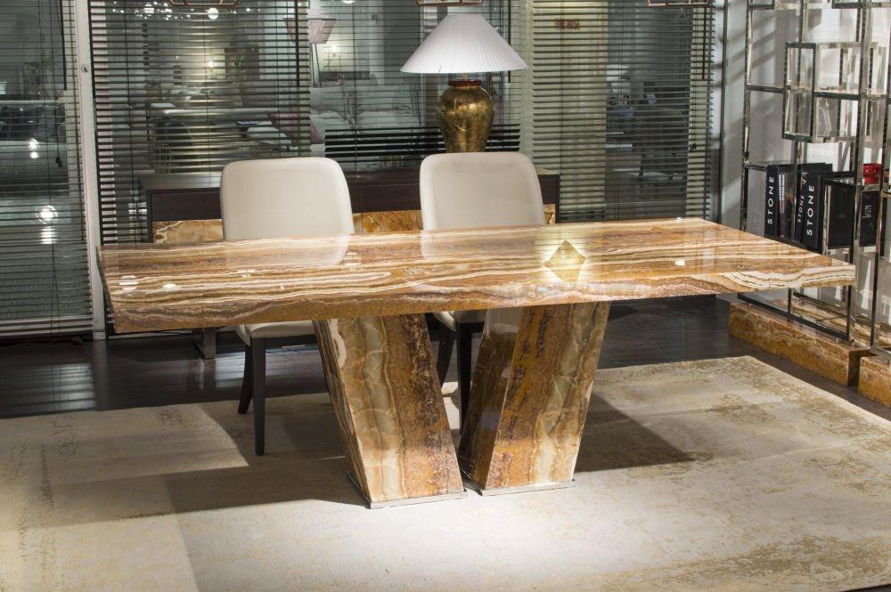 Product photograph showing Stone International Vertigo Marble Dining Table