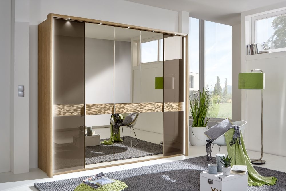 Wiemann Wega 7 Glass Door 3 Mirror Natural Wave Trim Wardrobe with LED Passepartout in Oak and Havana - W 350cm