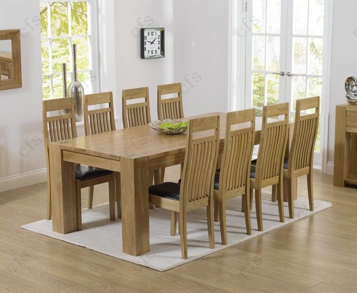 Mark Harris Tampa Solid Oak 220cm Dining Table with 6 Monte Carlo Black Chairs